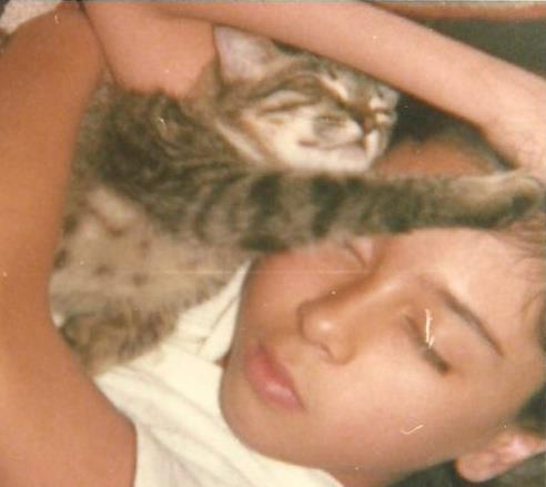Young Cristina and the cat Libertad